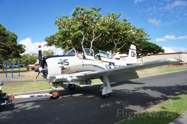 N787AS — - A T-28B being towed through Joint Base Pearl Harbor Hickam housing during a parade of warbirds.  The warbirds were on O'ahu to participate in the 75th Anniversary of VJ Day activities.  This T-28B will be loaded onto the USS Essex and shipped back to the mainland with 13 other warbirds after spending three weeks on and above O'ahu.