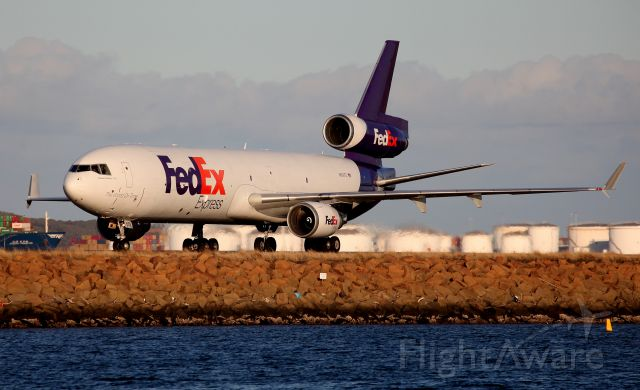 Boeing MD-11 (N602FE) - Taxiing to the Freight Ramp via Taxiway Alpha.