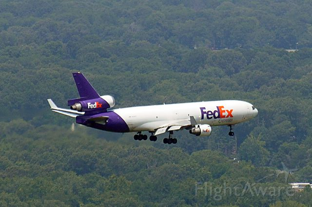 — — - Fed Ex jet landing at Memphis International Airport