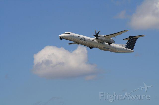 de Havilland Dash 8-300 (C-GLQE) - Porter Airlines leaving Montreal-Trudeau