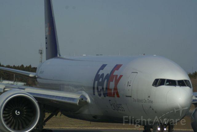 Boeing 777-200 (N855FD) - 16L/34R RWY