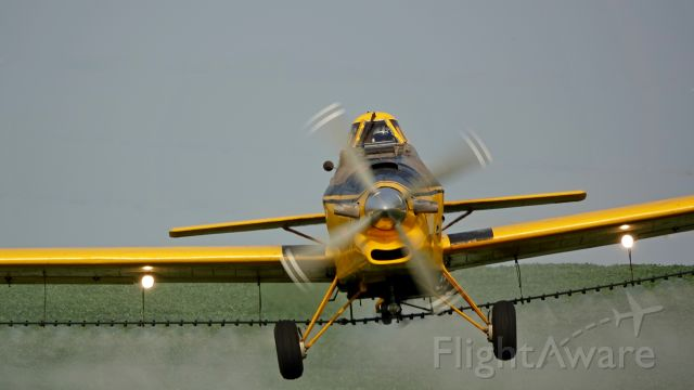 N40110 — - Crop duster in action.