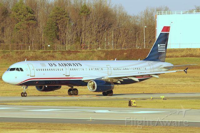 Airbus A321 (N560UW) - Awaiting departure 18C.