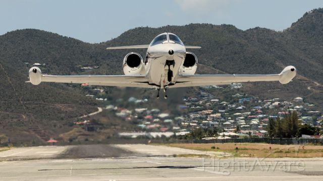Learjet 35 (N389KA) - Learjet N389KA departing St Maaten for Bonair off of runaway 28 some skillful pilots.