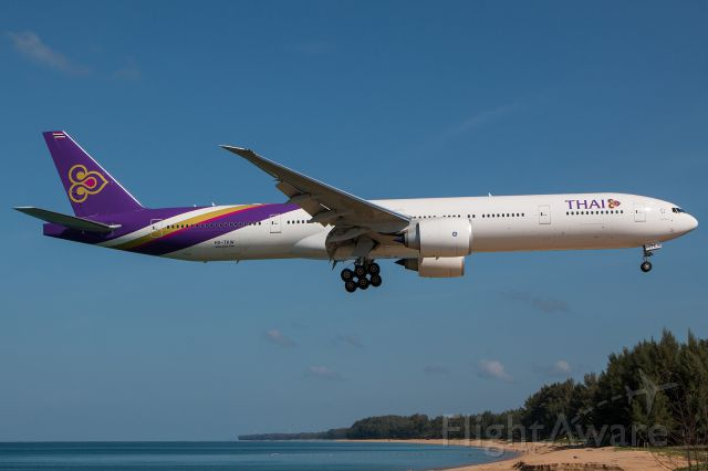 BOEING 777-300 (HS-TKW) - approach runway 09 over Nai Yang beach