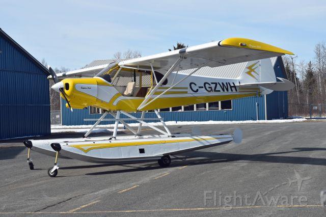 Piper L-21 Super Cub (C-GZWH) - 2003 Piper PA-18 Lazure Cub (C-GZWH/1098) sitting outside of its hangar on March 9, 2021