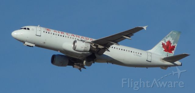 Airbus A320 (C-FDQV) - Taken on December 31, 2013. This Airbus A320 was taking off from runway 1 at Las Vegas McCarran Airport heading to Calgary International Airport in Alberta, Canada.