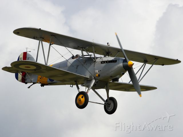 — — - A vintage Hawker Hind performs a flypast at Flying Legends 2012.
