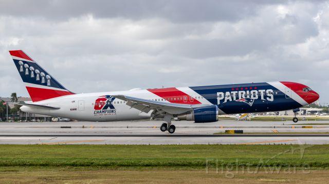 BOEING 767-300 (N36NE) - New England Patriots B767 landing on runway 10R at Ft. Lauderdale International Airport.