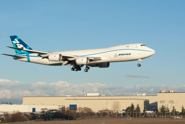 Boeing 747-200 (N747EX) - First landing. Note Boeing assembly plant in background