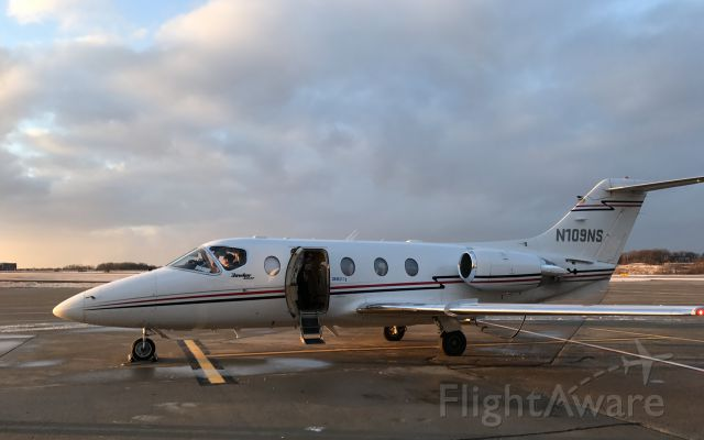 Beechcraft Beechjet (N109NS) - From gate D88 at KPIT, walking across taxiway, about to board flight # 1417 to BDL. Feb 16 2017 at 17:39.