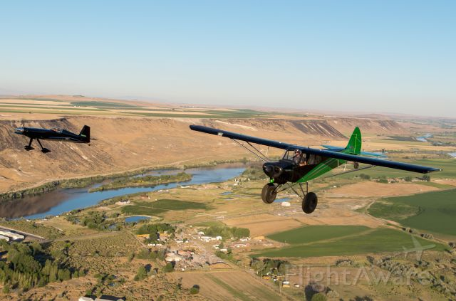 N7677M — - Formation flight south of Boise in the Snake River Canyon. Harmon Rocket III to the Left and a Javron Carbon Cub to the right.
