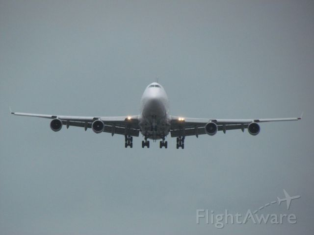 Boeing 747-400 (N400SA) - Taken on a rainy July 27 at KCVG from the viewing parking lot<br /><br />Southern Air Cargo 747-400 landing on runway 27