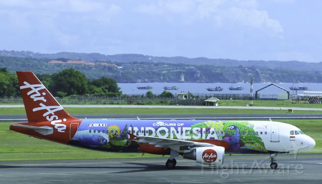 Airbus A320 (PK-AXD) - Here is an Air Asia A320 pulling into its gate in Bali shot from the terminal!