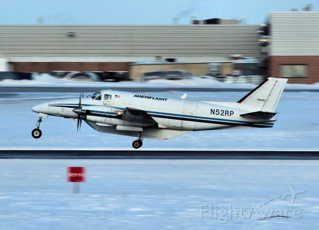 Beechcraft Airliner (N52RP) - Leaving rwy 25.