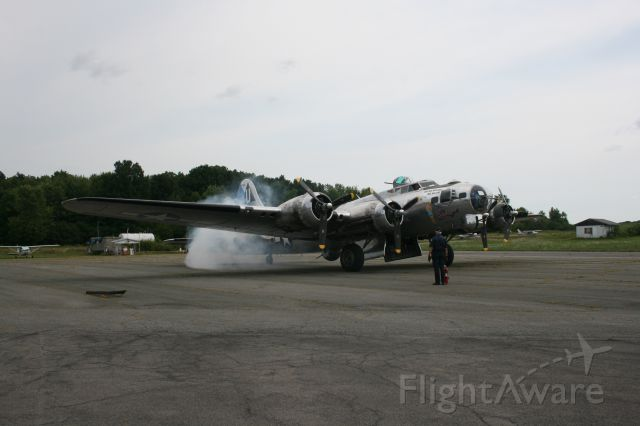— — - B17G Sentimental Journey starting engines at Schenectady County Airport on August 16,2014