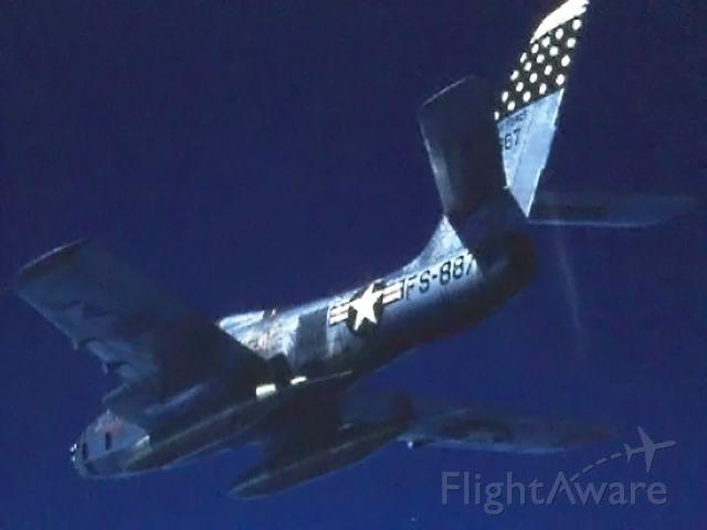 "— — - ""Belly shot"" of 45th TRS jet over Northern Japan- 1956"