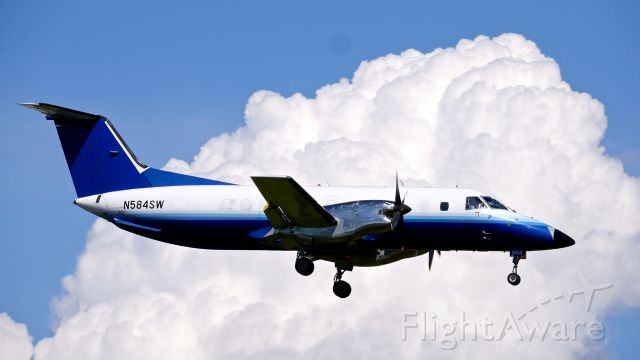 Embraer EMB-120 Brasilia (N584SW) - BYA688 from COE on final to Rwy 16R on 6.8.19. (EMB-120ER / cn 120352).