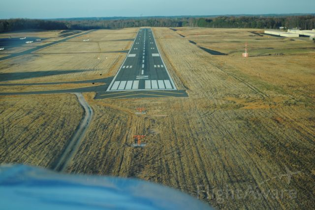 Beechcraft Bonanza (36) (N1116A) - Landing to the north on Runway 2 at KUZA