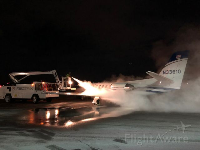 Cessna Citation II (N33610) - Unusual conditions caused ice formation on all exposed surfaces while parked at KBED, requiring a full deice prior to a late evening departure. The lighting created an interesting effect with the fluid spray, making it look as though the airplane was being deiced with a flame thrower.