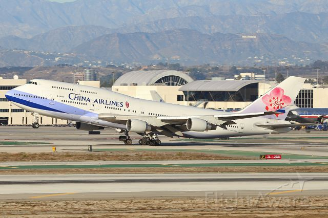 Boeing 747-400 (B-18207) - Taking off. The HOLLYWOOD sign is visible at the right upper corner.