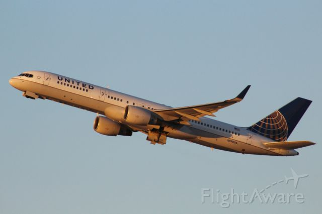 Boeing 757-200 (N598UA) - Early evening sun hitting the 757 after it took off from RW 25R